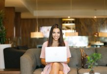 Shallow Focus Photo of Woman Sitting on Couch